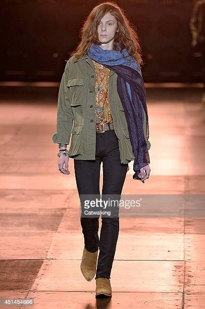 A model walks the runway at the Saint Laurent Spring Summer 2015 fashion show during Paris Menswear Fashion Week on June 29 2014 in Paris France