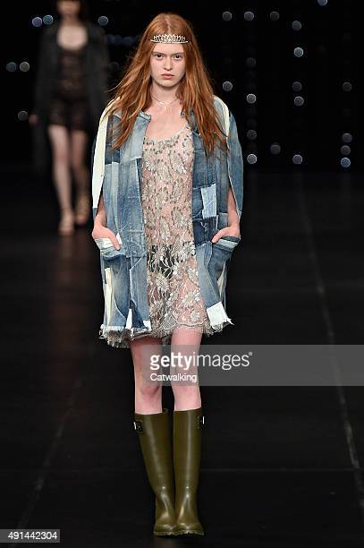 A model walks the runway at the Saint Laurent Spring Summer 2016 fashion show during Paris Fashion Week on October 5 2015 in Paris France