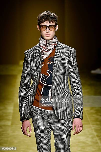 A model walks the runway at the Salvatore Ferragamo Autumn Winter 2016 fashion show during Milan Menswear Fashion Week on January 17 2016 in Milan...