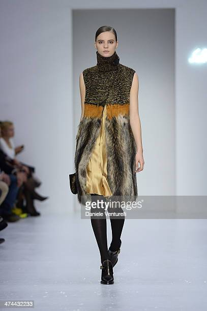 A model walks the runway at the Salvatore Ferragamo Show during Milan Fashion Week Womenswear Autumn/Winter 2014 on February 23 2014 in Milan Italy