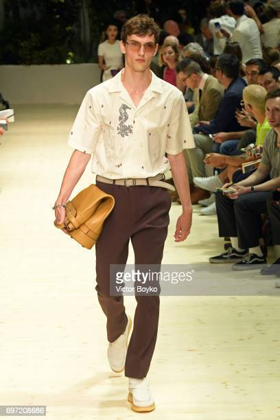 A model walks the runway at the Salvatore Ferragamo show during Milan Men's Fashion Week Spring/Summer 2018 on June 18 2017 in Milan Italy