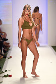 A model walks the runway at the San Lorenzo Bikinis 2017 Collections at SwimMiami at The W Hotel South Beach on July 17 2016 in Miami Florida