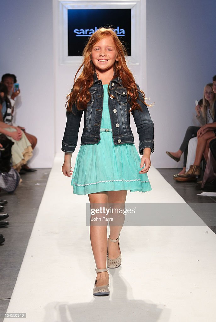 A model walks the runway at the Sarabanda show during Petite Parade NY Kids Fashion Week In Collaboration With VOGUEbambini - Day 2 at Industria Superstudio on October 21, 2012 in New York City.