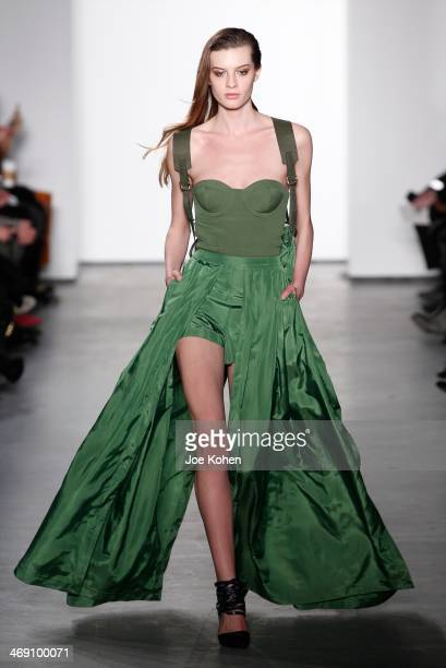 A model walks the runway at the Sass Bide fashion show during MercedesBenz Fashion Week Fall 2014 at The Waterfront on February 12 2014 in New York...