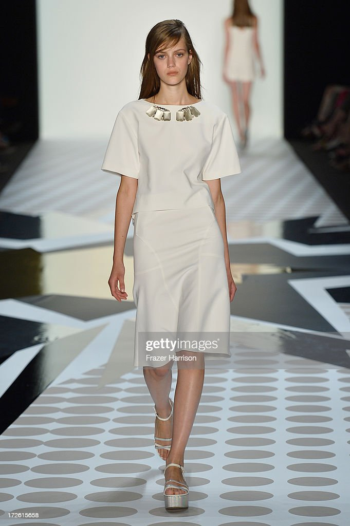 A model walks the runway at the Schumacher Show during the Mercedes-Benz Fashion Week Spring/Summer 2014 at Brandenburg Gate on July 4, 2013 in Berlin, Germany