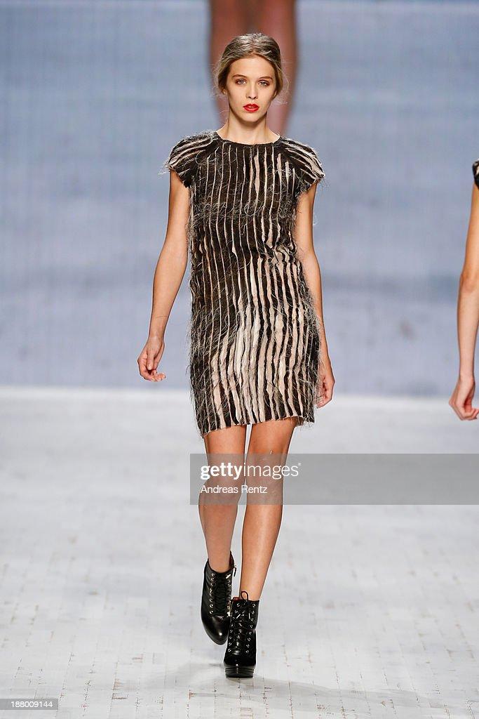 A model walks the runway at the Seam show during Mercedes-Benz Fashion Days Zurich 2013 on November 14, 2013 in Zurich, Switzerland.
