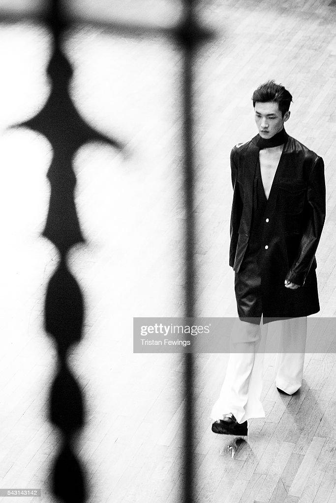 A model walks the runway at the Sean Suen Menswear Spring/Summer 2017 show as part of Paris Fashion Week on June 26, 2016 in Paris, France.