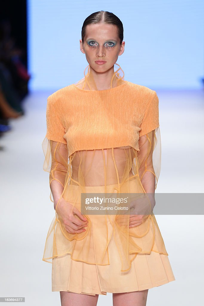 A model walks the runway at the Selma State show during Mercedes-Benz Fashion Week Istanbul s/s 2014 presented by American Express on October 9, 2013 in Istanbul, Turkey.
