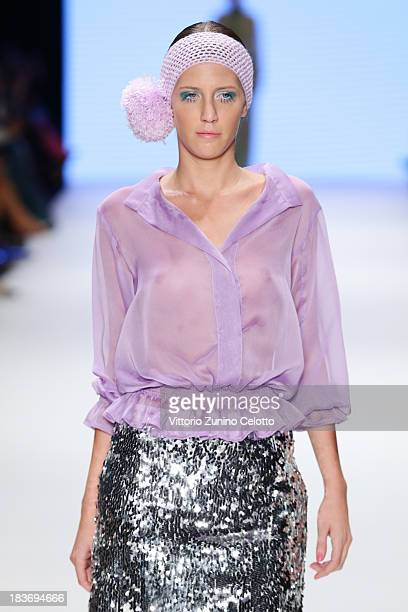 A model walks the runway at the Selma State show during MercedesBenz Fashion Week Istanbul s/s 2014 presented by American Express on October 9 2013...