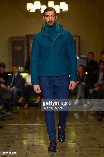 A model walks the runway at the Serdar Uzuntas show during Mercedes Benz Fashion Week Istanbul FW15 on March 20 2015 in Istanbul Turkey