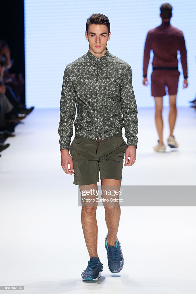A model walks the runway at the Serdar Uzuntas show during Mercedes-Benz Fashion Week Istanbul s/s 2014 presented by American Express on October 9, 2013 in Istanbul, Turkey.