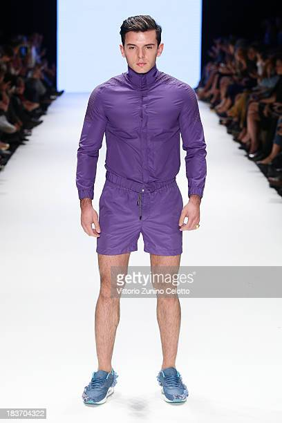 A model walks the runway at the Serdar Uzuntas show during MercedesBenz Fashion Week Istanbul s/s 2014 presented by American Express on October 9...