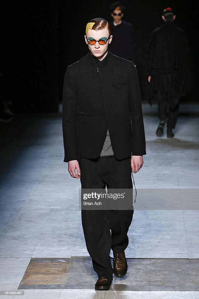A model walks the runway at the Siki Im fashion show during Fall 2013 Mercedes-Benz Fashion Week at Cafe Rouge on February 12, 2013 in New York City.