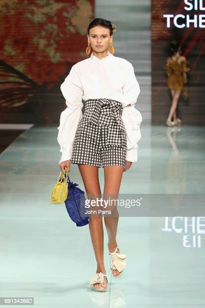 A model walks the runway at the Silvia Tcherassi Runway Show during Miami Fashion Week at Ice Palace Film Studios on June 1 2017 in Miami Florida