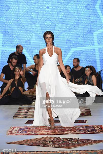 A model walks the runway at the Simay Bulbul show during Mercedes Benz Fashion Week Istanbul SS15 at Antrepo 3 on October 14 2014 in Istanbul Turkey