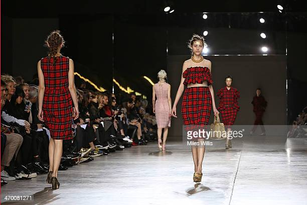 A model walks the runway at the Simone Rocha show at London Fashion Week AW14 at Tate Modern on February 18 2014 in London England