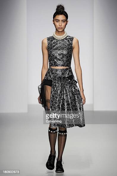 A model walks the runway at the Simone Rocha Spring Summer 2014 fashion show during London Fashion Week on September 17 2013 in London United Kingdom