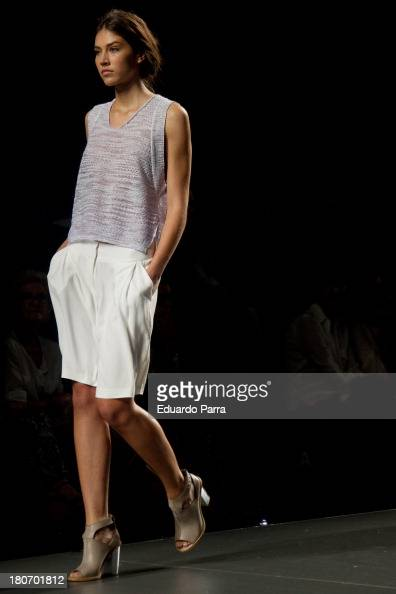 A model walks the runway at the Sita Murt show during Mercedes Benz Fashion Week Madrid Spring/Summer 2014 on September 16 2013 in Madrid Spain