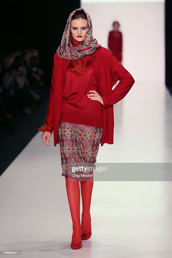 A model walks the runway at the SLAVA ZAITSEV For Ufa Knitwear LLC,TM 'TRICARDO' show during the Mercedes-Benz Fashion Week Russia S/S 2014 on October 25, 2013 in Moscow, Russia.