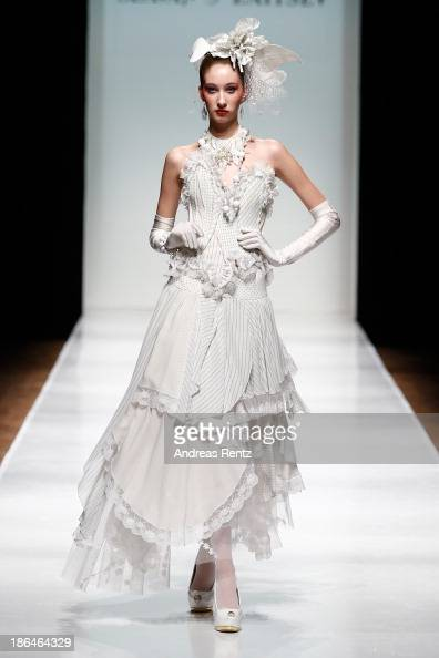 A model walks the runway at the SLAVA ZAITSEV Haute Couture show during MercedesBenz Fashion Week Russia S/S 2014 on October 31 2013 in Moscow Russia
