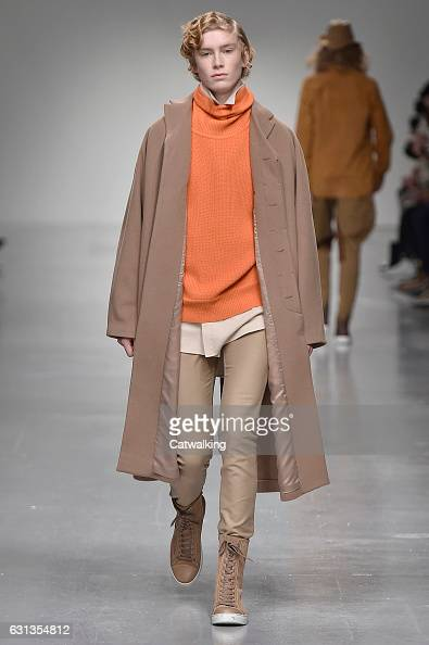 A model walks the runway at the Songzio Autumn Winter 2017 fashion show during London Menswear Fashion Week on January 9 2017 in London United Kingdom