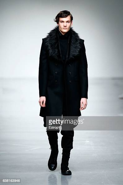 A model walks the runway at the SONGZIO show during London Fashion Week Men's January 2017 collections at BFC Show Space on January 9 2017 in London...