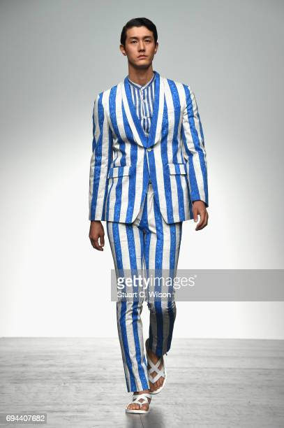 A model walks the runway at the SONGZIO show during the London Fashion Week Men's June 2017 collections on June 10 2017 in London England