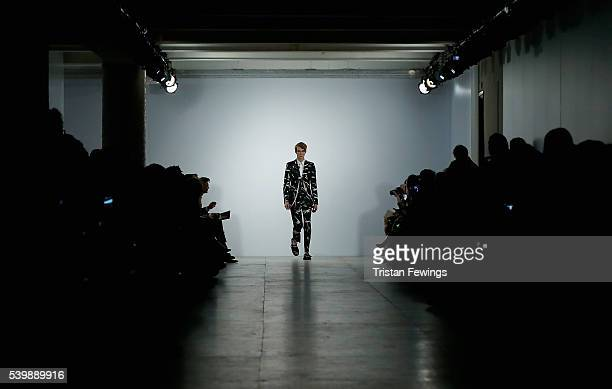 A model walks the runway at the Songzio show during The London Collections Men SS17 at BFC Show Space on June 13 2016 in London England