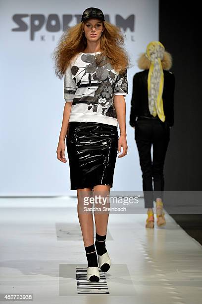 A model walks the runway at the Sportalm Show during Platform Fashion Dusseldorf on July 26 2014 in Duesseldorf Germany