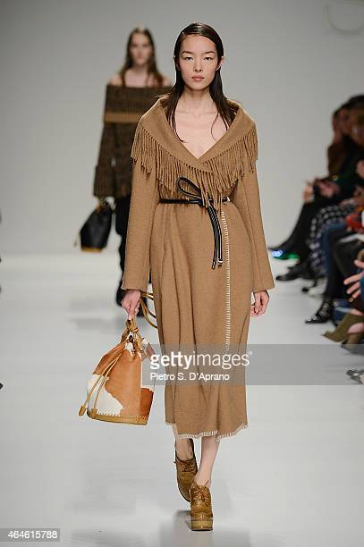 A model walks the runway at the Sportmax show during the Milan Fashion Week Autumn/Winter 2015 on February 27 2015 in Milan Italy