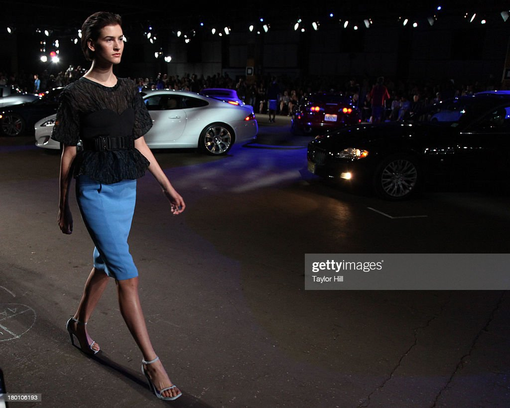 A model walks the runway at the Spring 2014 show of Opening Ceremony at Pier 57 at on September 8, 2013 in New York City.