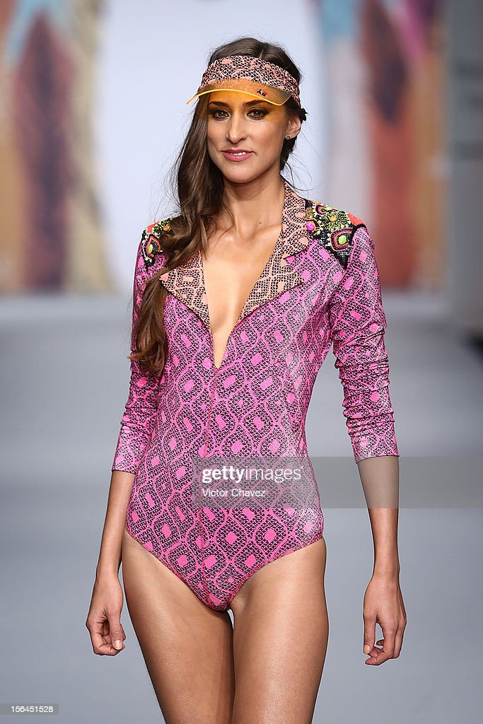 A model walks the runway at the spring/summer 2013 collection of Agua Bendita during the third day of Mereceds-Benz Fashion Week Mexico at Carpa Santa Fe on November 14, 2012 in Mexico City, Mexico.