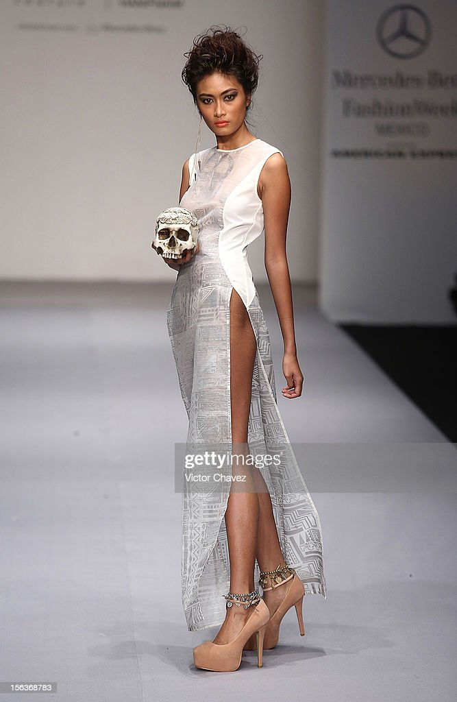 A model walks the runway at the spring/summer 2013 collection of Bill Keith Couture & Hanif Naime during the second day of Mereceds-Benz Fashion Week Mexico at Carpa Santa Fe on November 13, 2012 in Mexico City, Mexico.