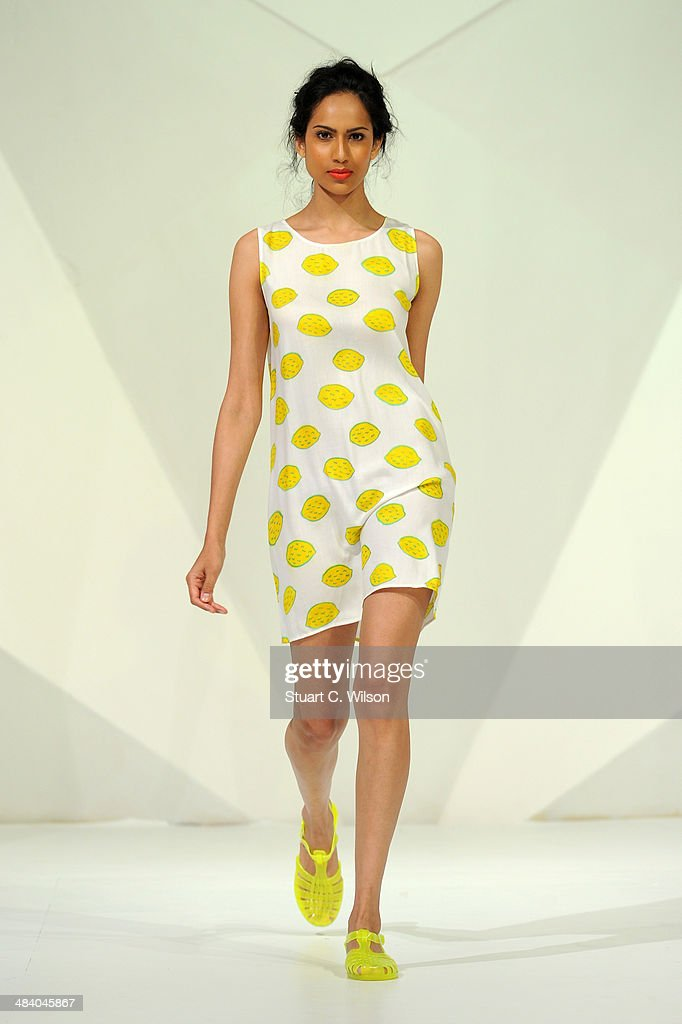A model walks the runway at the Starch show during Fashion Forward at Madinat Jumeirah on April 11, 2014 in Dubai, United Arab Emirates.