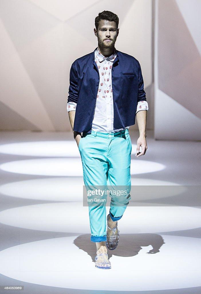 A model walks the runway at the Starch show during Fashion Forward at Madinat Jumeirah on April 11, 2014 in Dubai, United Arab Emirates.