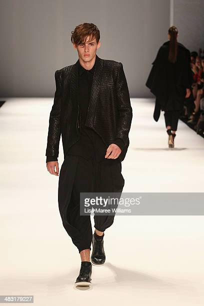 A model walks the runway at the StrateasCarlucci show during MercedesBenz Fashion Week Australia 2014 at Carriageworks on April 7 2014 in Sydney...