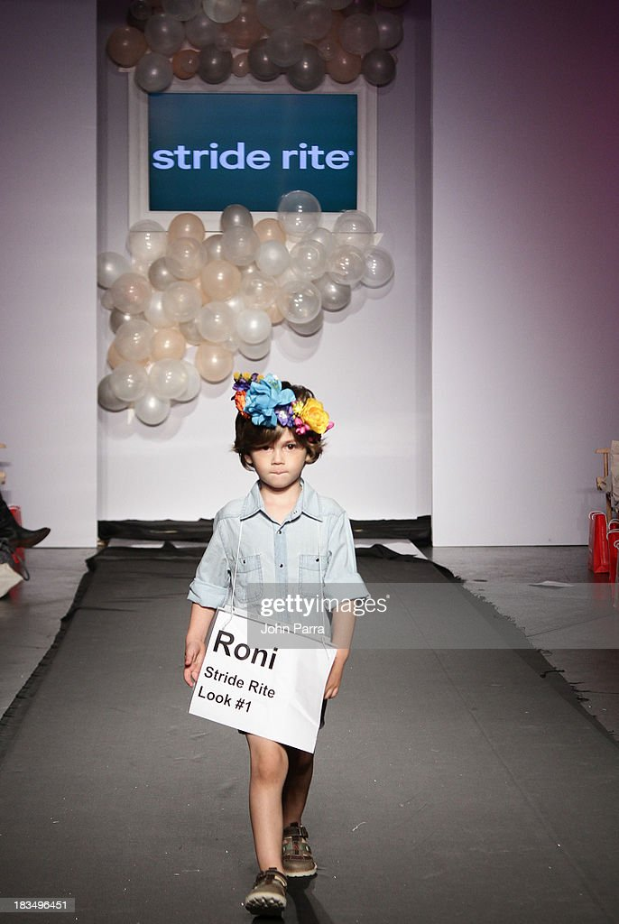 A model walks the runway at the Stride Rite show during the petiteParade NY Kids Fashion Week in Collaboration with VOGUE Bambini on October 6, 2013 in New York City.