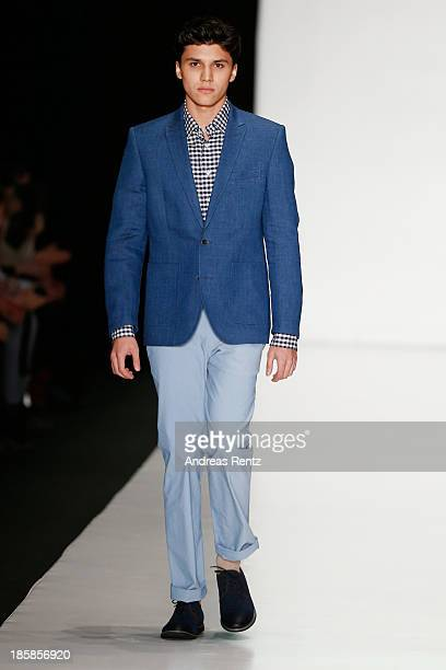 A model walks the runway at the 'Sudar' PLC TM 'VENZANO' Styled By 'Leonid Alexeev' show during the MercedesBenz Fashion Week Russia S/S 2014 on...