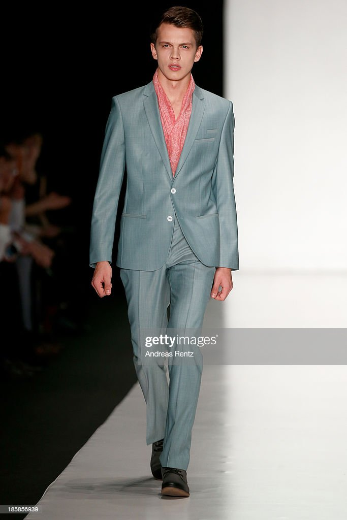 A model walks the runway at the 'Sudar' PLC, TM 'VENZANO'. Styled By 'Leonid Alexeev' show during the Mercedes-Benz Fashion Week Russia S/S 2014 on October 25, 2013 in Moscow, Russia.