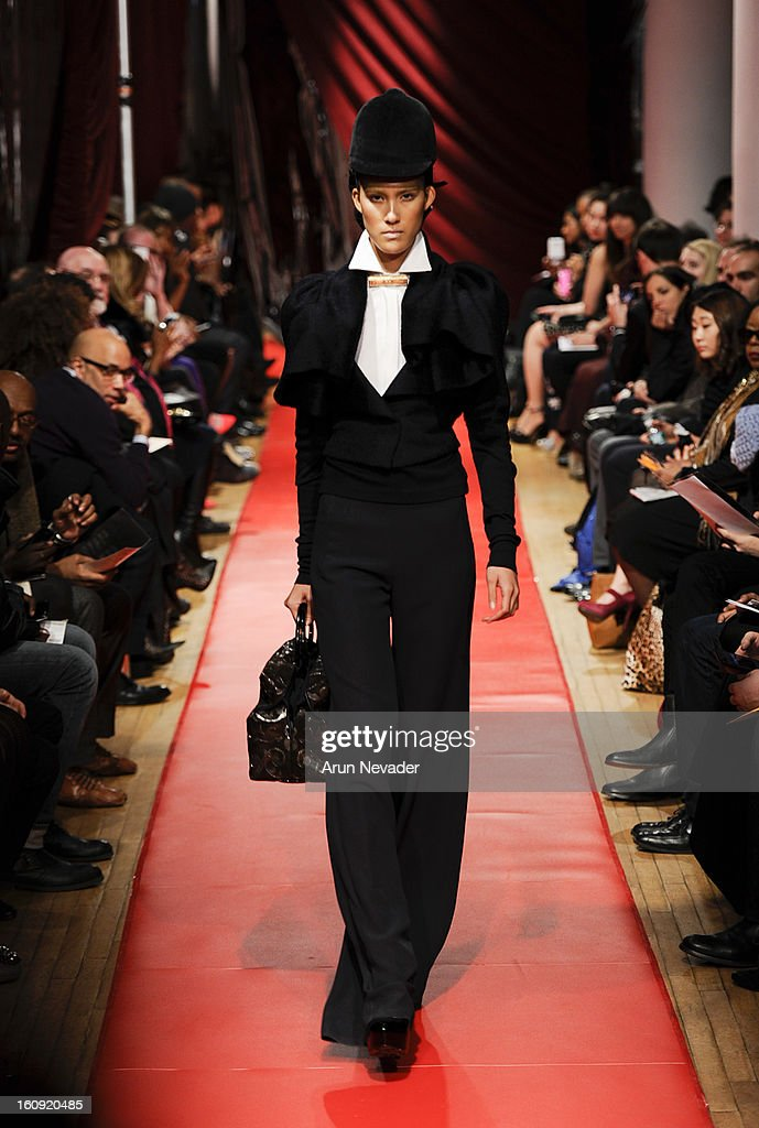 A model walks the runway at the Sukeina Fall 2013 Fashion Show during Mercedes-Benz Fashion Week at Helen Mills Event Space on February 7, 2013 in New York City.
