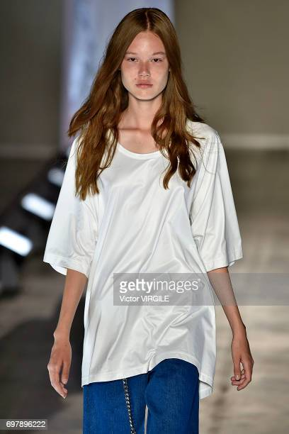 A model walks the runway at the Sulvam fashion show during Milan Men's Fashion Week Spring/Summer 2018 on June 18 2017 in Milan Italy