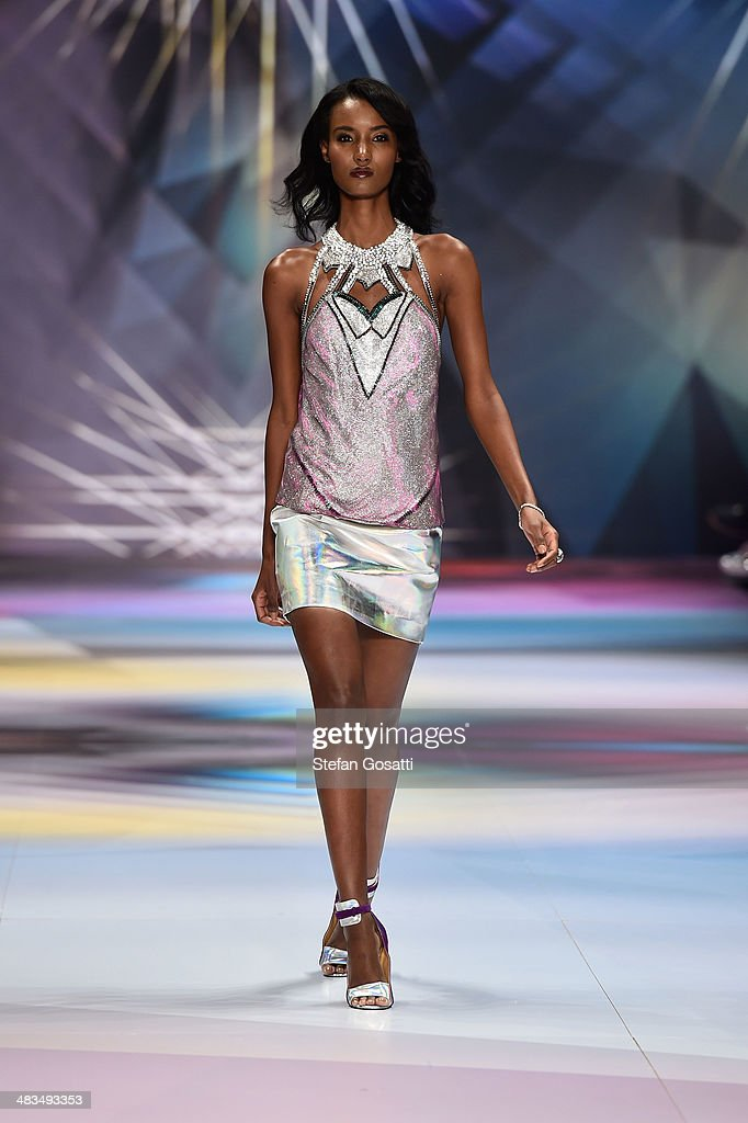 A model walks the runway at the Swarovski show during Mercedes-Benz Fashion Week Australia 2014 at Carriageworks on April 9, 2014 in Sydney, Australia.