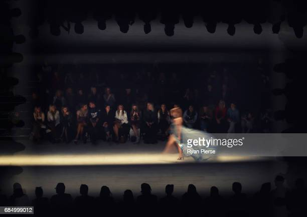 A model walks the runway at the Swim show at MercedesBenz Fashion Week Resort 18 Collections at Carriageworks on May 17 2017 in Sydney Australia