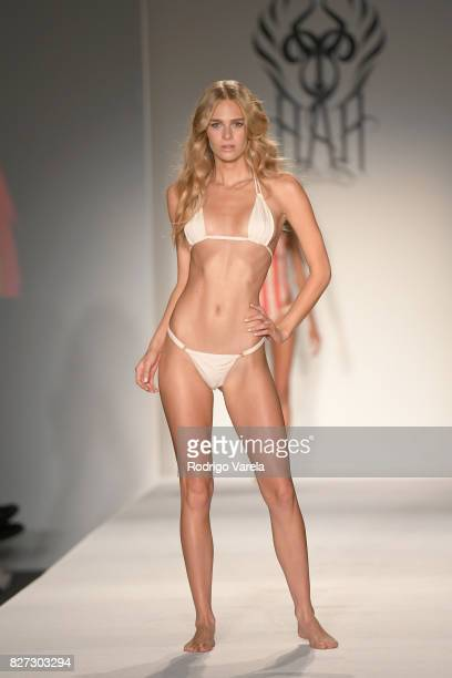 A model walks the runway at the SWIMMIAMI HotAsHell 2018 Collection fashion show at 227 22nd Street on July 21 2017 in Miami Beach Florida