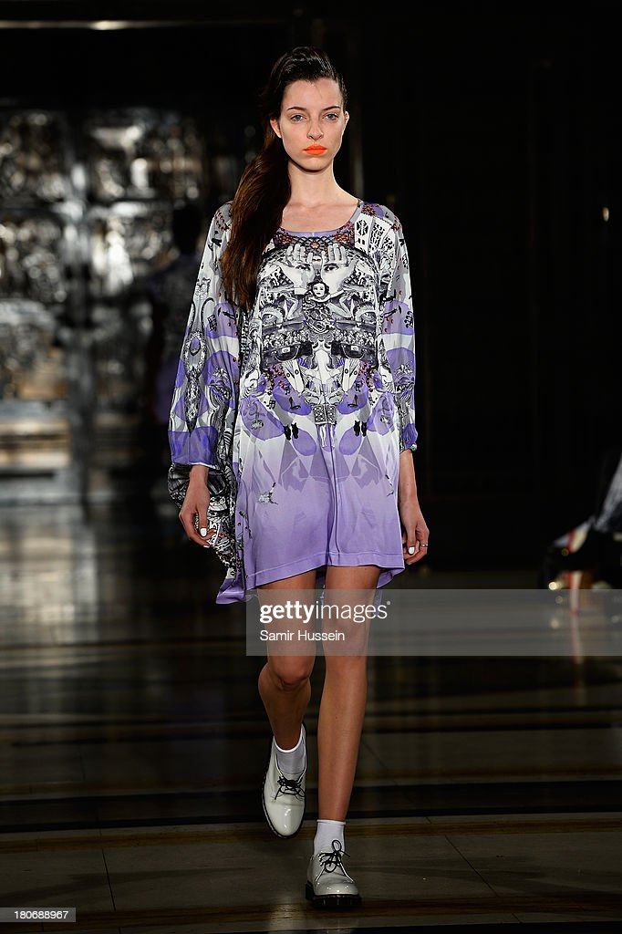 A model walks the runway at the Tabernacle Twins show during at the Fashion Scout venue during London Fashion Week SS14 at Freemasons Hall on September 16, 2013 in London, England.