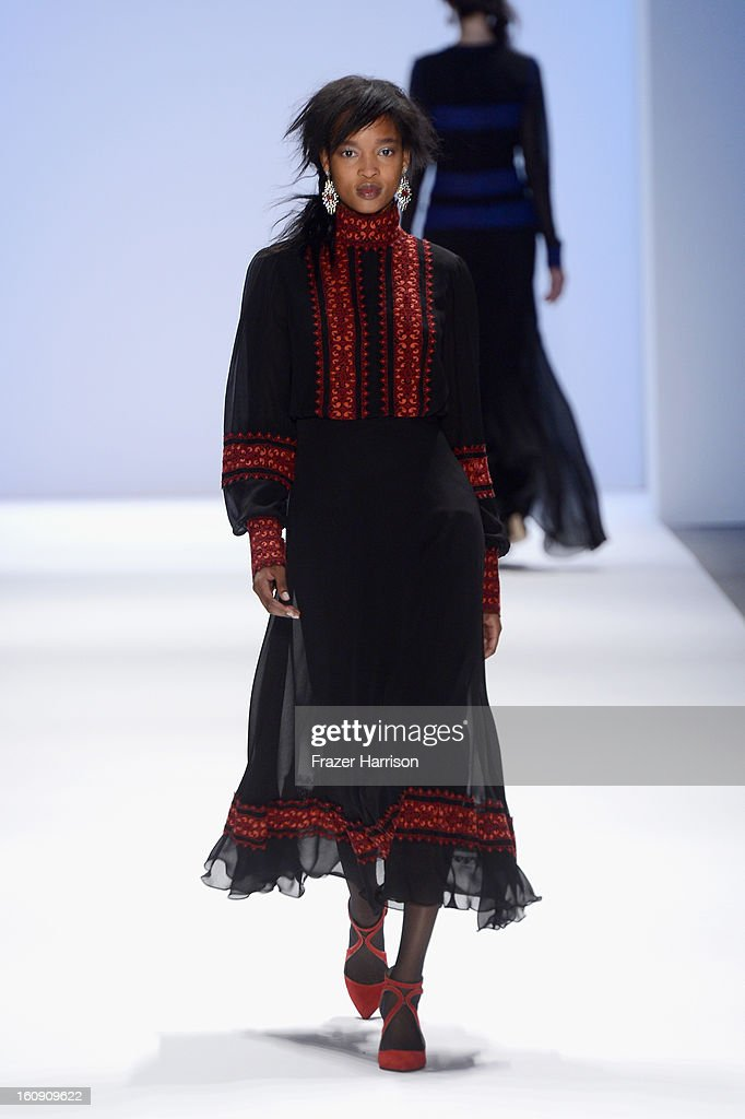 A model walks the runway at the Tadashi Shoji Fall 2013 fashion show during Mercedes-Benz Fashion Week at The Stage at Lincoln Center on February 7, 2013 in New York City.