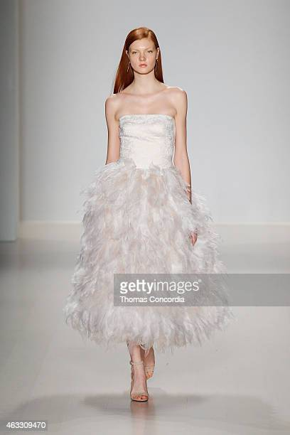 A model walks the runway at the Tadashi Shoji show during MercedesBenz Fashion Week Fall 2015 at The Salon at Lincoln Center on February 12 2015 in...