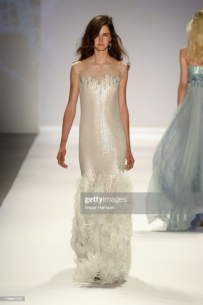 A model walks the runway at the Tadashi Shoji Spring 2014 fashion show during Mercedes-Benz Fashion Week at The Stage at Lincoln Center on September 5, 2013 in New York City.