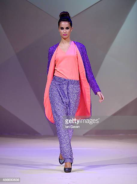 A model walks the runway at the Tahir Sultan presented by W Retreat Spa Maldives show during Fashion Forward at Madinat Jumeirah on October 5 2014 in...