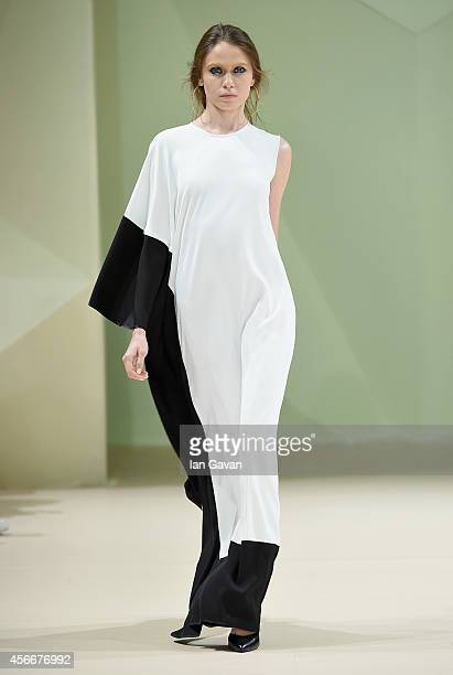 A model walks the runway at the Taller Marmo show during Fashion Forward at Madinat Jumeirah on October 5 2014 in Dubai United Arab Emirates